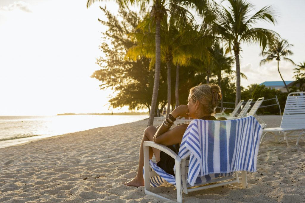 adult woman sitting in beach chair, Grand Cayman Island